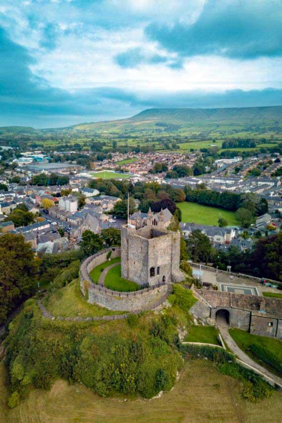 Clitheroe castle and pendle hill portrait