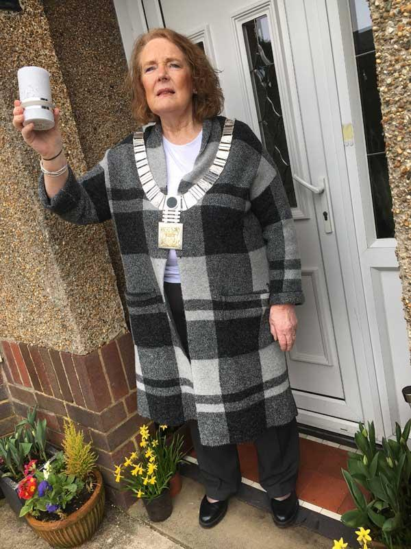 Ribble Valley Mayor Stella Brunskill outside house with a candle
